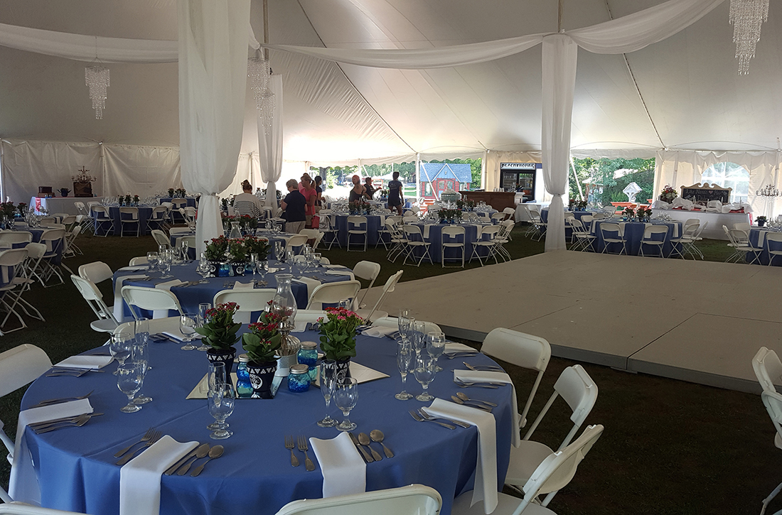 Catskill Mountain Weddings Table Settings and Dance Floor under huge tent at Blackthorne Resort
